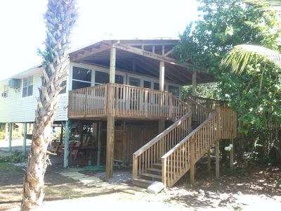 Our island home. Wonderful covered porch for outdoor dining and relaxing.