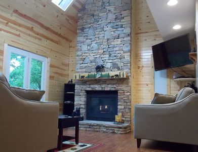 Living Room with stacked stone fireplace.