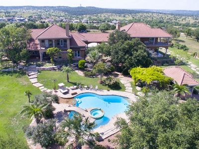 Photo for Deluxe vacation home overlooking golf course with pool/spa, dog-friendly!