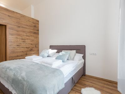 Photo for Wooden decorated apartment near river and central bus station by easyBNB