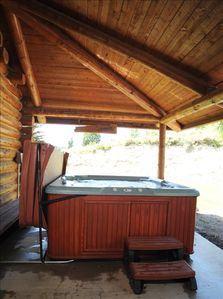 Covered hot tub for year round enjoyment