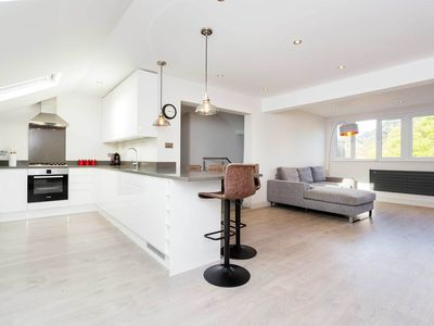 Photo for Reach Waterloo station in 25 mins from a minimalist 2 bed in Wimbledon (Veeve)