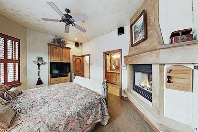 """Master Bedroom - Curl up and watch favorite shows on the 40"""" flat-screen TV in the master suite."""