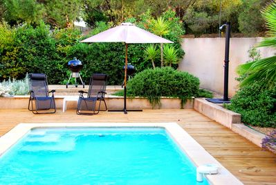 Private garden with heated pool