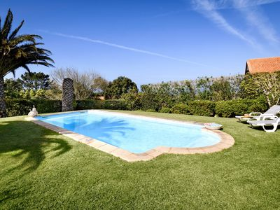 Photo for Villa with a stunning view over the Atlantic, beautiful garden, pool and bbq