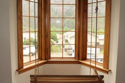Swing chair by picture window