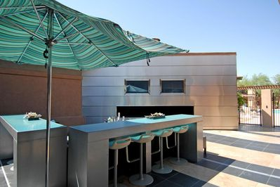 Outdoor TVs and sitting area at main pool off of Great room club house