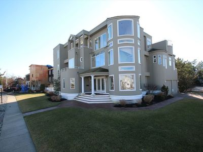 Photo for Beautiful contemporary home on a corner lot with 3 floors and an elevator. 5 bedrooms, 5 full baths and 1 half bath