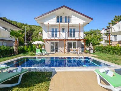 Photo for 4 Bed 3 bath w/private pool,  close tos Hisaronu shopes, bars and restaurants in a quiet location. Free A/C, WiFi & pool towels, built-in BBQ, hairdryers.