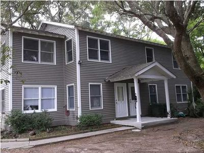 Nestled under the oaks with a large yard on a quiet, residential street.