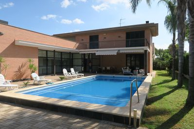 Swimming pool, terrace and side garden