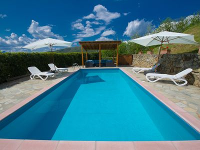 Photo for Stunning hilltop house in Barga, Tuscany with private pool and spectacular views