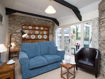 Cosy lounge with patio doors to courtyard