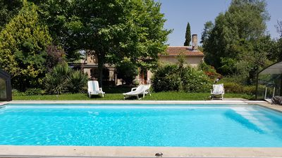 Photo for Provencal country house with swimming pool and wooded grounds