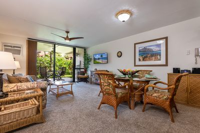 Roomy-great-room with garden view through lanai door.
