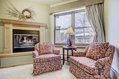 Take a seat by the fireplace and warm up during the colder winter days.