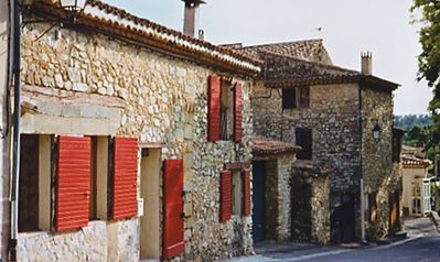 Front of the stone house (with red shutters) in an authentic Provencal village!