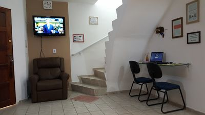 Photo for Duplex on the beach of Guarujá cove, with balcony and individual barbecue area.
