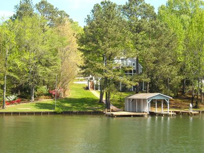 Boat house has lots of chairs and loungers. Paddle boat.