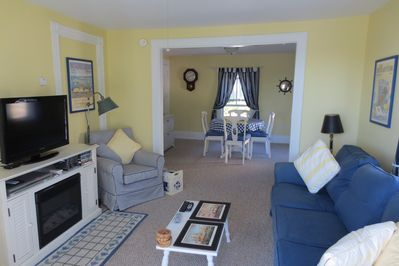 Bright sitting room, with views over Mill Cove. TV, Free WIFI, Fireplace.