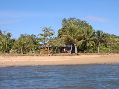 Photo for charming waterfront cottage near a coconut beach, great view