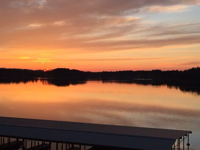 Photo for Beautiful Lake view condo, balcony sunset, great location.