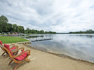 Sandy beach area and a dock to moor your boat.