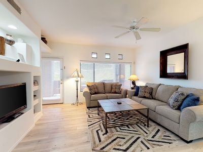 Photo for Lovely condo w/ patio, desert views & shared pool, hot tub, & gym!