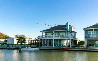 Photo for NEW LISTING! Beautiful home located on a canal on Copano Bay!  Public Kayak launch just a few lots d