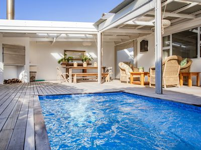 Photo for Short walk to beach, private pool, bbq deck and on-site tennis courts