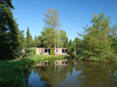 Photo for Ground-floor bungalow, directly by the fishing pond, in holiday park with beauti