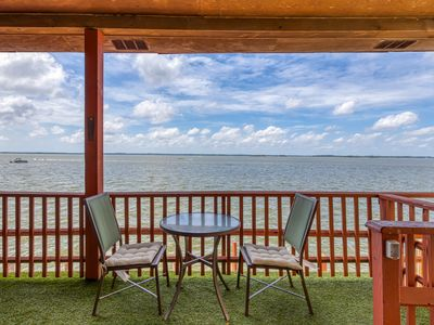 Photo for Enjoy direct waterfront living from this condo w/ furnished deck & free WiFi!