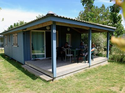 Photo for Comfortable chalet with a porch near the Atlantic coast