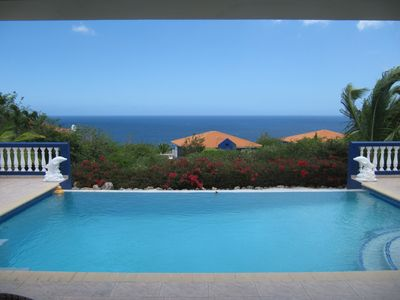 Relax on the back lanai and enjoy the pool and caribbean sea