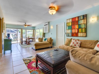 Photo for Rental on the ocean side w/ canal access, patio, shared dock and enclosed yard