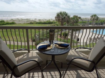 WATERFRONT BALCONY OVERLOOKING OCEAN WITH COMFY SEATING FOR 4 & 2 BISTRO TABLES