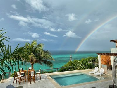 THE VILLA'S 180 DEGREE VIEW OF THE BLUE CANCUN ISLA MUJERES OCEAN