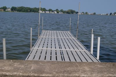 24 feet of dock, water is waste deep at end of dock. Only 2-3 feet at break wall