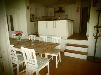 Dining Room with steps leading to kitchen.