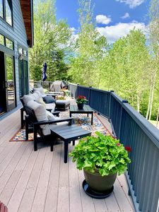 Photo for RE53: GORGEOUS DECK WITH FANTASTIC VIEWS, HOT TUB AND AC!!!  Beautifully decorated home next to the ski slopes