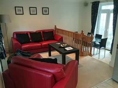 Open Plan Living & Dining area with Juliet balcony also access to garden patio.