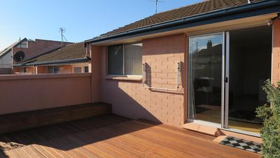 Deck at back of unit -sunny & nice to relax