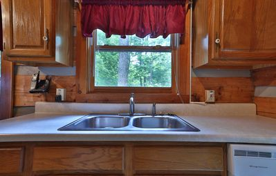 Double stainless sink and adjacent dishwasher.