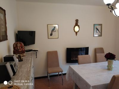 Photo for Sunny terrace and a short distance from the beach.