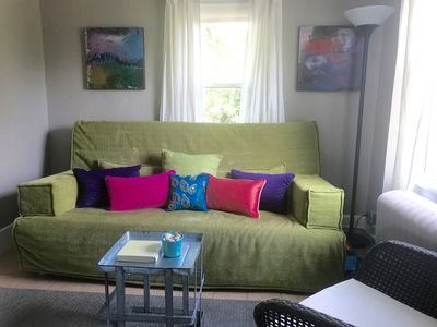 Small living room with futon sofa bed