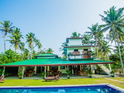 Photo for 5 Bedrooms, Private Pool sleeps 12  - 2 minute walk to the beach