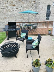 Fenced in Back Yard with New Grill and Fire pit