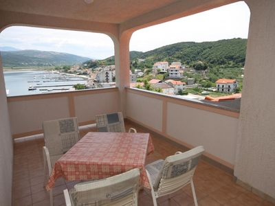 Photo for Two bedroom apartment with terrace and sea view Supetarska Draga - Donja, Rab (A-2013-a)