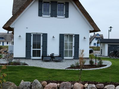 Photo for New Thatched Cottage with Lake View - modern and charming - 3 bedrooms & sauna