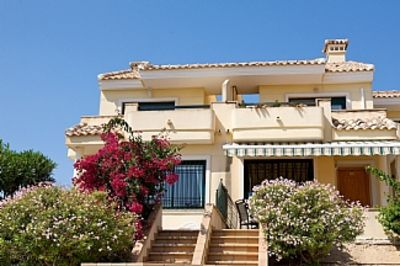 Photo for Town House On Campoamor Golf Resort With Communal Pool And Sea Views